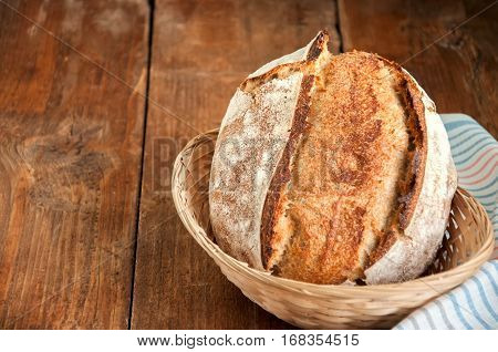 Freshly Baked Sourdough Bread In A Basket On A Wooden Table