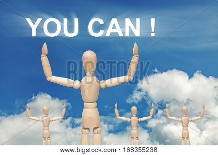Wooden dummy puppet on sky background with words YOU CAN . Abstract conceptual image