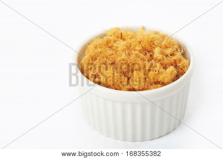 pork floss isolated in white cup on a white background.