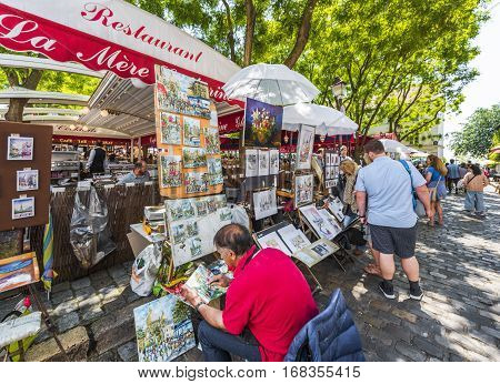Paris, France - June 2016: Artists at work at Montmartre on a sunny day