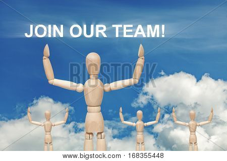 Wooden dummy puppet on sky background with words JOIN OUR TEAM. Abstract conceptual image