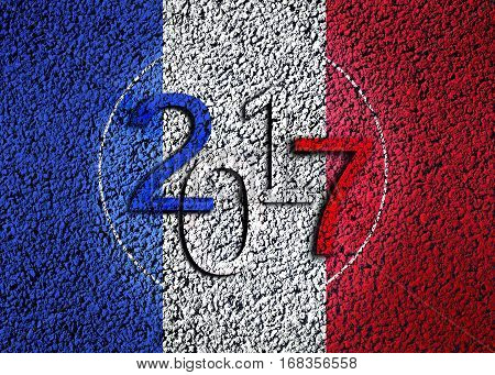 2017 on french tricolor flag on textured background