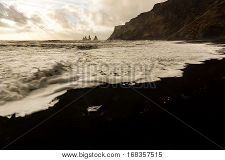 The famous Reynisdrangar sea stacks outside the small town Vik in south Iceland in dawn