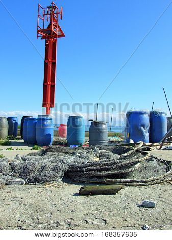 Fishnets and blue barrels on the wharf. The Vistula's Sandbar, Poland. June, 2016.
