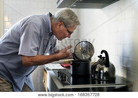 Senior Man Cooking Food Kitchen