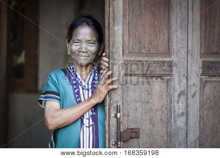 Chin region Myanmar November 11 2014: daai tribe woman at her front door