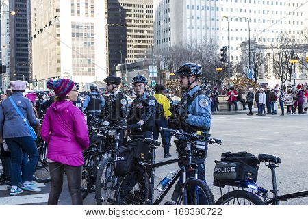 Chicago IL United States - January 21 2017: Chicago police officers blocking the street in downtown Chicago during Women's March on January 21 2017.