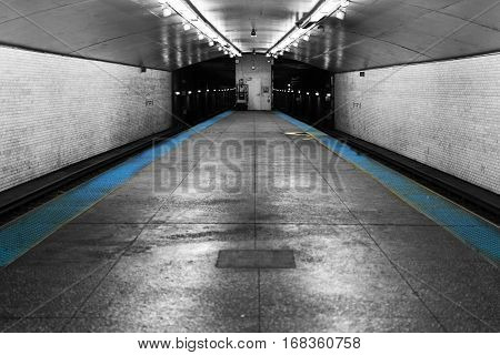 A picture of an empty nameless subway station in Chicago. No people present.