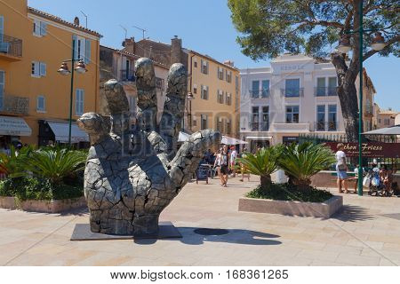 SAINT-TROPEZ, FRANCE - AUG 2, 2016: Sculpture in form of an elongated palm with five fingers raised