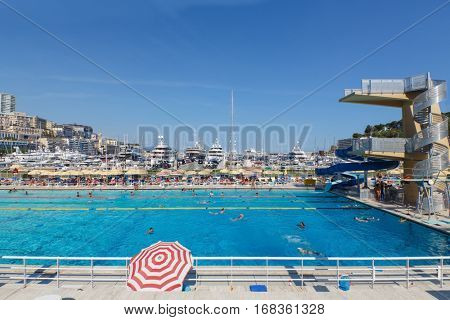 MONTE CARLO, MONACO - AUG 3, 2016: Stade Nautique Rainier III, outdoor water sports stadium, which is located in heart of Port Hercule with trampolines and slide for children