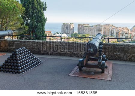 cannonballs and cannon near palace, which belongs to Prince of Monaco