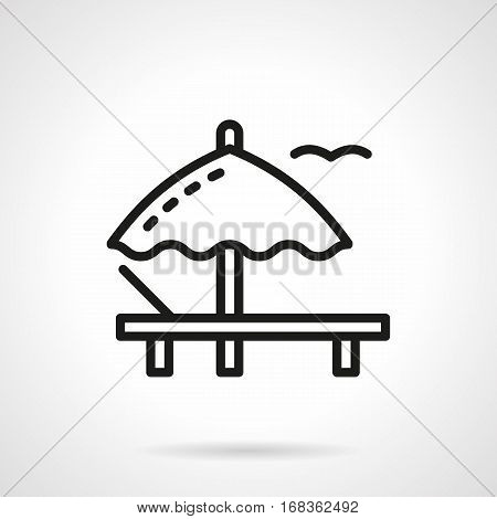 Symbol of beach umbrella and lounger. Comfortable rest on deckchair near a sea. Summer resort. Black simple line design vector icon.