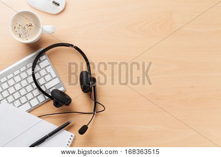 Office desk with headset and pc. Call center support table. Top veiw with copy space