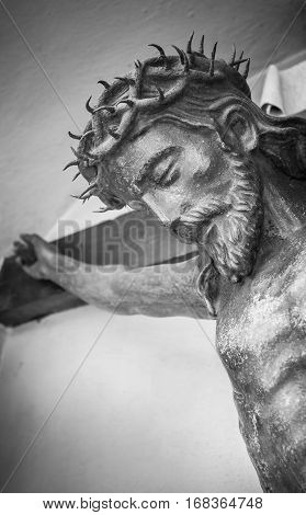 The suffering of Jesus Christ. Details of the bronze statue.