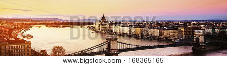 Budapest, Hungary. Chain bridge and Parliament building in Budapest, Hungary at sunset. Yellow toning