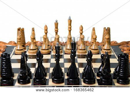 The chess pieces are placed on the chessboard. Defeated black king. The player admitted defeat