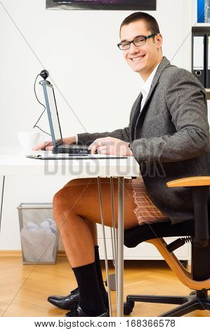 businessman having a teleconference, wearing no pants. how good that cameras always only show a little piece of reality.