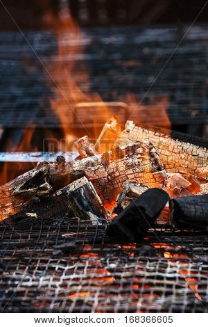 charcoal fire grill, close up with live flames.
