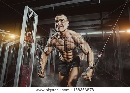 Athlete Muscular Bodybuilder Training On Simulator In The Gym. Chest Training In Gym