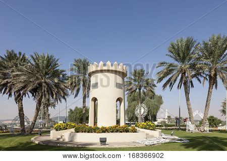 MEZAIRAA, UAE - DEC 4, 2016: Replica of a traditional arabian tower in a roundabout in Mezairaa. Liwa Oasis area Emirate of Abu Dhabi United Arab Emirates