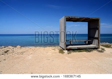 Bench inside wooden frameб relax place on the Cyprus sea coastб Kato Pahos seaside