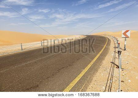 Desert road to the Moreeb Dune in Liwa Oasis area. Emirate of Abu Dhabi United Arab Emirates