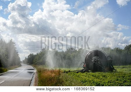 Danish summer when the crops in the field requires water of an agricultural irrigation system to give the best yield. Irrigation Pivot. Agriculture. Denmark