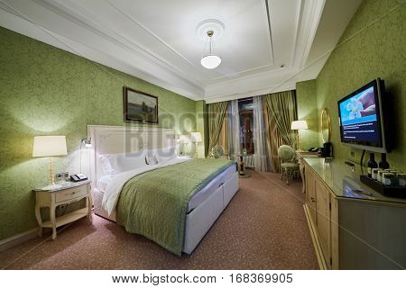 MOSCOW, RUSSIA - NOV 13, 2015: Interior of double room in hotel Radisson Royal Ukraine, one of the seven Stalin skyscrapers.