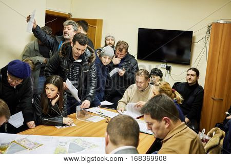 MOSCOW, RUSSIA - NOV 11, 2015: Residential complex owners discuss allocated land in Bogorodskoe district during public hearing.