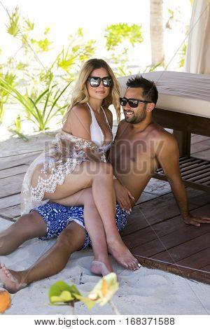 Honeymoon romantic lovers vacation on a tropical beach. Young happy lovers on romantic travel honeymoon having fun on vacation summer holidays romance.