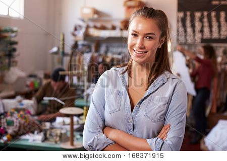Smiling white female trainee in clothing design studio
