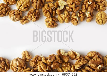 Kernels walnuts on a white background. Walnuts at border of image with copy space for text.