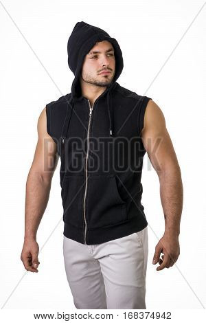 Confident muscular male bodybuilder during bulking phase or mass period, posing isolated on white.