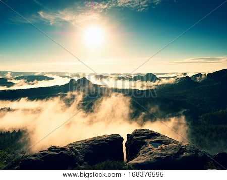 Spring Colorful Mist Between Summits. Cliff Above Forest