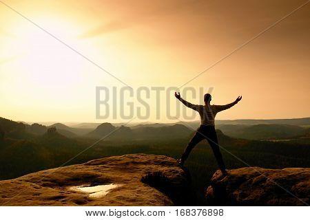 Summit Achievemnt. Hiker In Black Celebrate Triumph