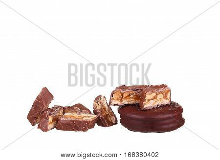 Tasty Chocolate Bar Split In Two Pieces. Delicious Caramel Cream And Peanuts Inside.white Background