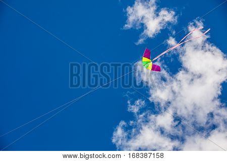 kite flying on sky background with clouds