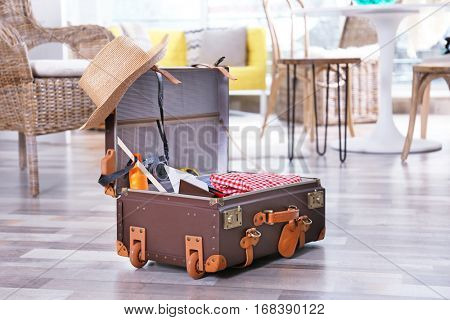 Packed traveller suitcase on the floor at home