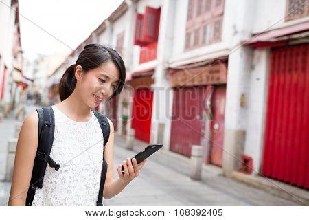 Woman using mobile phone in Macao city
