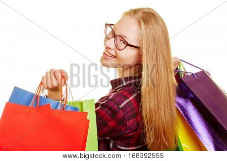 Smiling blond woman shooping looks over her shoulder
