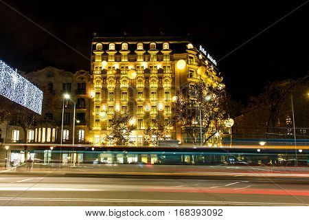 Barcelona Spain - January 03 2017: Night traffic on the Passeig de Gracia street in the background of Hotel Majestic
