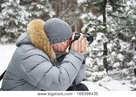 Winter forest man photographer. photographer in forest