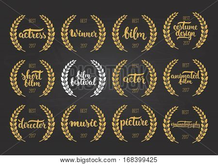 Set of awards for best film actor picture animated costume design cinematography actress director music and winner for movie festival with wreath and 2017 text isolated on the black chalkboard