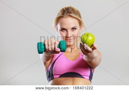 Diet Fit Body. Girl Holds Dumbbells And Apple Fruit