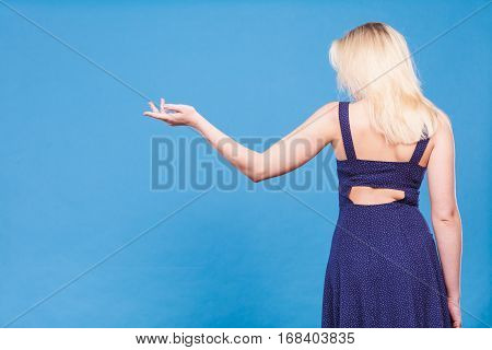 Woman Wearing Navy Dress Pointing Left Open Hand