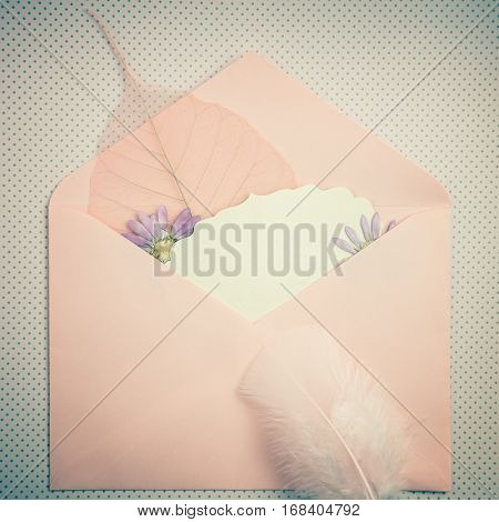 Memory nostalgic concept background - wonderful past time, an envelope with cute things, vintage