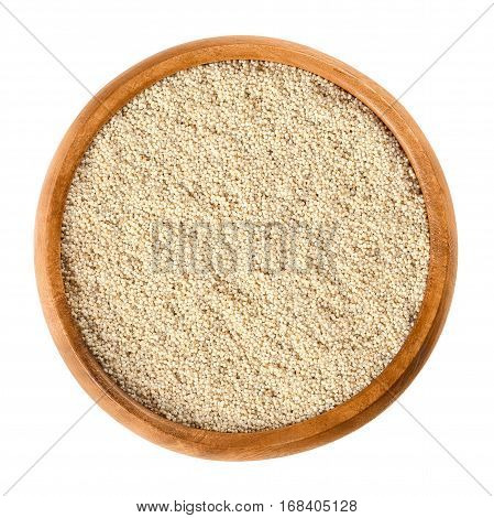 White poppy seeds in wooden bowl. Oilseed from opium poppy Paper somniferum with tiny kidney shaped seeds. Dried fruits are used whole or ground. Isolated macro food photo close up on white background