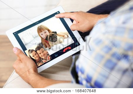 Video call and chat concept. Man video conferencing on tablet