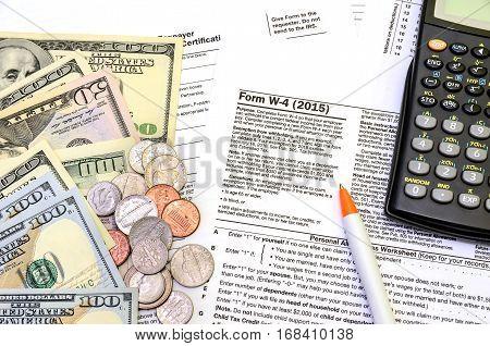 tax form w-4 dollar coin close up