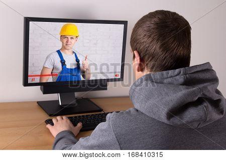 Man Watching Builder's Video Blog